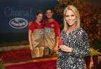 Ocean Spray Farmer-Owners Lauren and Clinton May can't curb their enthusiasm for Cheryl Hines. The starlet stopped by Ocean Spray's Star Bar at the Kari Feinstein Lounge Thursday Sept. 14 in Los Angeles to celebrate the start of awards season. (PRNewsfoto/Ocean Spray)