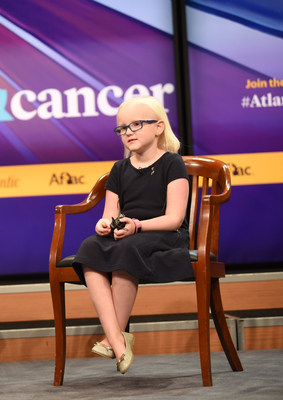 Eight-year old Caroline Belcher from Virginia addresses the audience at today's Children & Cancer Forum sponsored by Aflac, which has contributed more than $118 million for the treatment and research of childhood cancer. Caroline told her emotional story about her battle with multiple brain tumors.