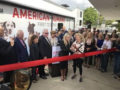 A GIANT GIFT FOR CALIFORNIA'S ANIMALS American Humane President and CEO Dr. Robin Ganzert and philanthropist Lois Pope cut the ribbon for a giant, new 50-foot animal rescue truck that will help safeguard the animals of the West Coast during disasters.