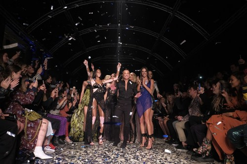 Global superstar Alessandra Ambrosio made a surprise arrival at Julien Macdonald's Spring / Summer '18 London Fashion Week runway show in London tonight, Monday, Sept. 18 2017, dazzling in a stunning party dress inspired by luxury vodka brand CÎROC. Alessandra and Julien are pictured together with Winne Harlow at the close of the glittering show, shortly after her surprise appearance. (PRNewsfoto/CÎROC)