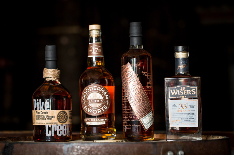 Corby showcases Canadian whisky with the Northern Border Collection Rare Release: Lot No. 40 12 Year Old Cask Strength, Gooderham & Worts Little Trinity 17 Year Old Three Grain, J.P. Wiser's 35 Year Old, and Pike Creek 21 Year Old (CNW Group/Corby Spirit and Wine Communications)