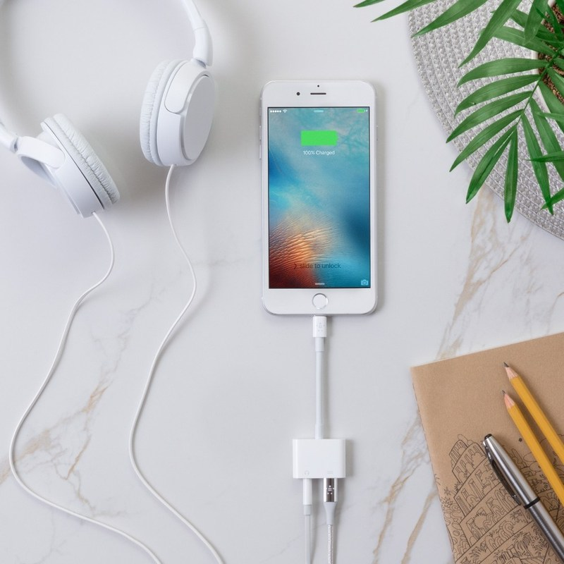 3.5 mm Audio + Charge RockStar adapter for the iPhone 8, iPhone 8 Plus, iPhone X, iPhone 7, iPhone 7 Plus. The 3.5 mm Audio + Charge RockStar plugs into the Lightning connector, offering a way for users to simultaneously charge their iPhone and listen to music using 3.5 mm headphone jack devices