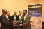 Professor Sani Abubakar Mashi, Director General of NIMET and Ayodeji Soetan, UBIMET Sustainable Development Expert, shake hands after signing the MoU (PRNewsfoto/UBIMET)