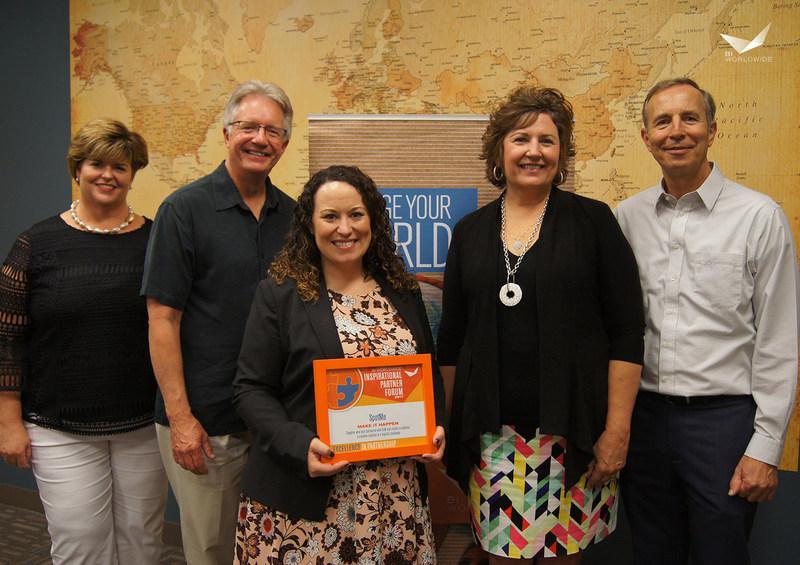 "Allison Greene, Director of Sales at SpotMe, accepting the ""Make it Happen"" award at the BI WORLDWIDE Inspirational Partner Forum"