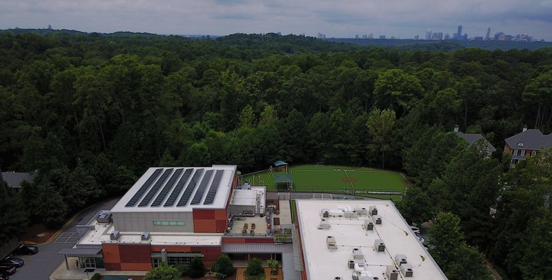 With the city of Atlanta in the background, Cliff Valley School's gymnasium roof is covered with solar panels.