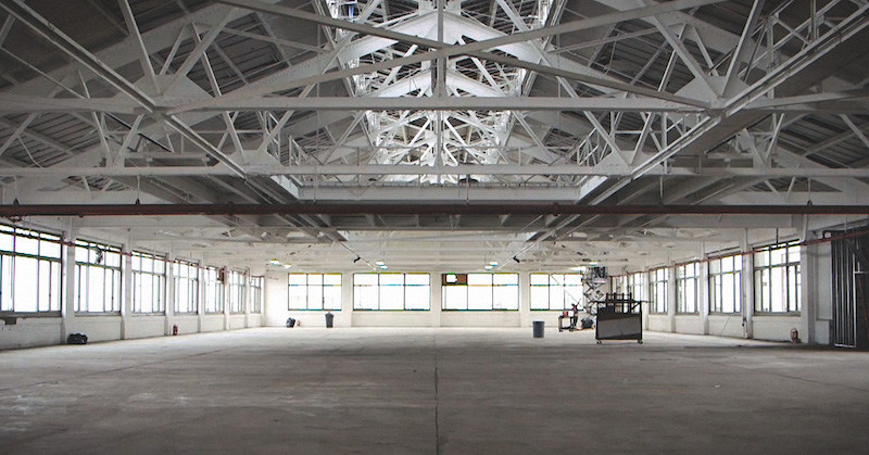 Socceroof's warehouse space provides the perfect layout for ten 80' x 50' soccer fields and plenty of windows for a skyline view of New York.