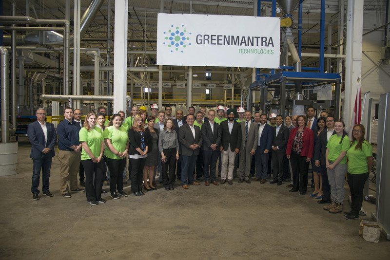 GreenMantra employees standing in front of production line.