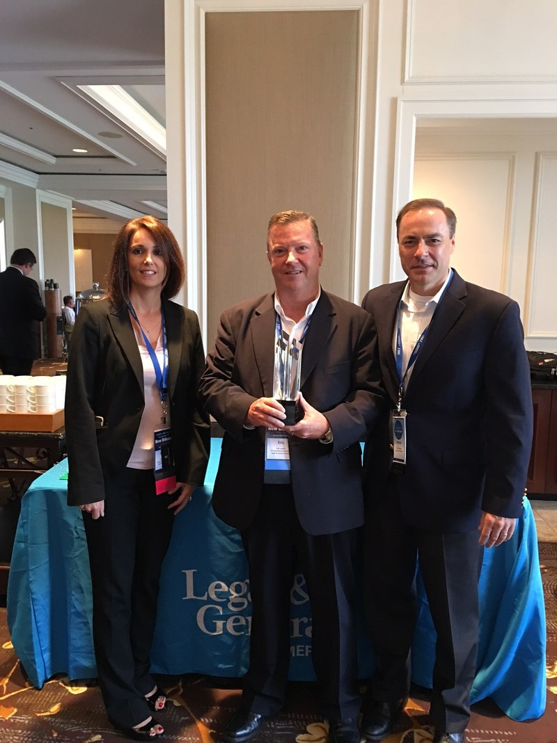Brooke Vemuri, Assistant VP New Business; Eric W Lester, VP Administrative Services; Patrick M. Bowen, CLU, Senior Vice President, Distribution of Legal & General America accept 2017 LIDMA Innovation Award.