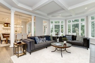 A sunlit Family Room, with trimmed box beam ceiling, looking into the gourmet Kitchen in the Gulick Group Winthrop, one of the planned homes at Summer Creek. Some optional features shown. https://gulickgroup.com (PRNewsfoto/Gulick Group, Inc.)