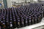 Freshly brewed bottles of Labatt Blue come off the bottle line at the Labatt brewery in London, Ontario (CNW Group/Labatt Breweries of Canada)