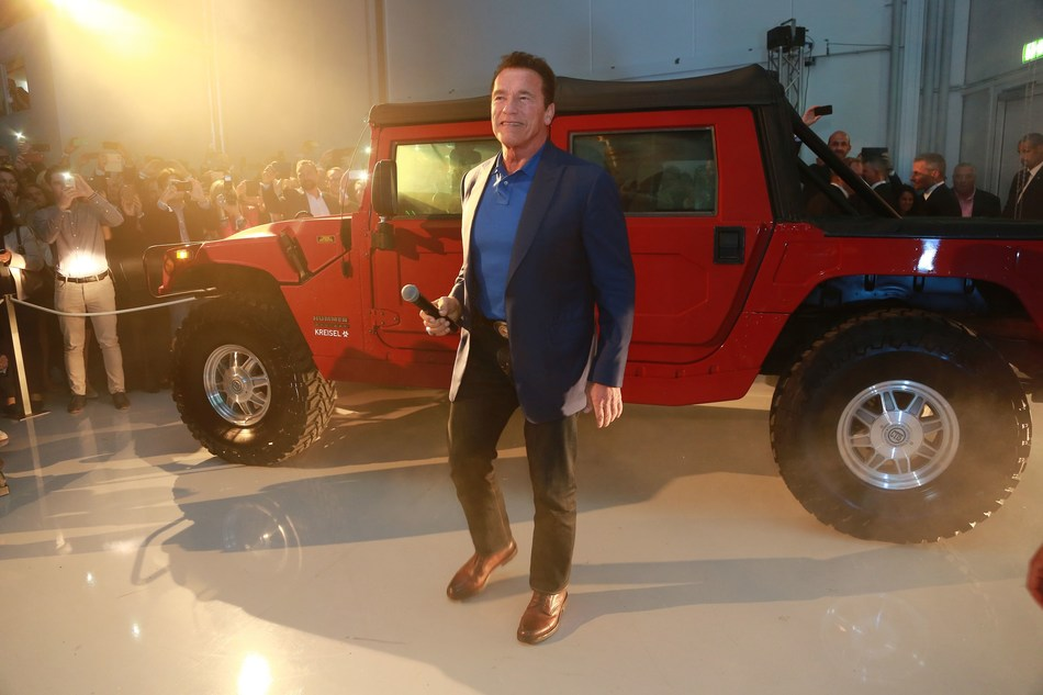 Arnold Schwarzenegger in front of the world's first electrified Hummer H1 at the opening of the Kreisel Electric high-tech research and development center (Copyright: Martin Hesz / Kreisel Electric) (PRNewsfoto/Kreisel Electric)