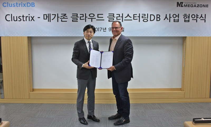 Clustrix CEO Mike Azevedo, on right, and MEGAZONE CSO & Founder Max Lee with signed partnership agreement at MEGAZONE's Seoul office