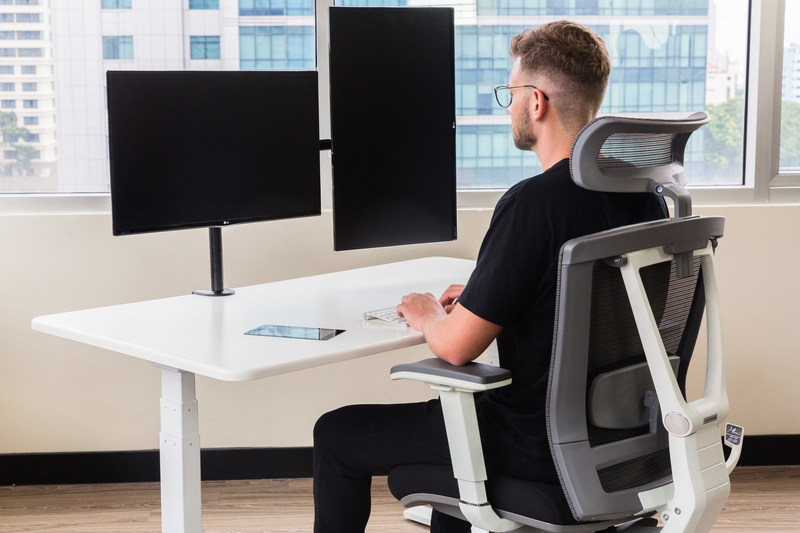 The Autonomous Smart Desk 3 AI-powered standing desk, in its seated position