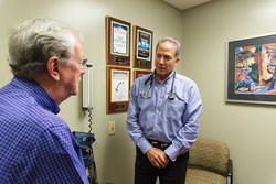 Joining the MDVIP network in 2007 has enabled Dr. Lawrence Gassner (right), an internist in Phoenix, Ariz., to spend much more time with patients compared to a traditional practice and provide them highly individualized preventive care. Credit: MDVIP