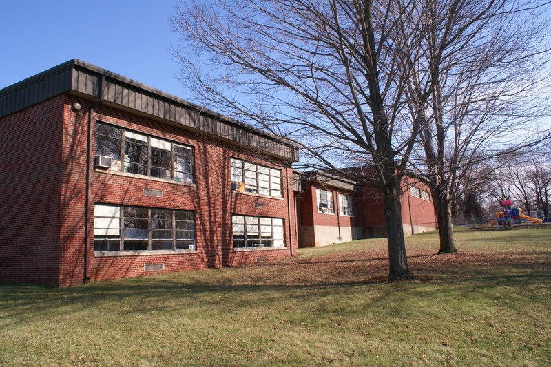 7 acres in prime Cleveland suburb, at major intersection - school building no additional charge!
