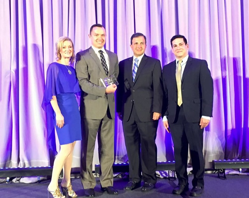 Tint World® franchisee Danny Shenko (second from the left) receives his Franchisee of the Year award at the IFA Franchise Action Network Annual Meeting in Washington, D.C.