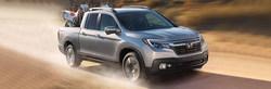 2018 Honda Ridgeline driving with cargo
