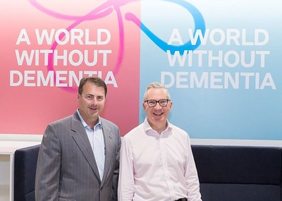 Left Paul Hogan founder of Home Instead Senior Care, right Jeremy Hughes, CEO of Alzheimer's Society in the UK. (PRNewsfoto/Home Instead Senior Care)