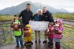 Princess Cruises Vice President of Public Affairs Ralph Samuels presents a $25,000 check to the Alaska Wildlife Conservation Center Board Member Karen Cowart, the cruise line's first donation recipient from the Princess Animal Welfare Sponsor (PAWS). PAWS supports local causes and charities that foster nature, animals and wildlife. Also pictured: Animal Planet's Dave Salmoni with local kids holding Stanley the Bears