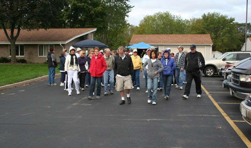 Members of the St. William Society of St. Vincent de Paul Conference in Waukesha, Wis. are joined by people from the community at the 2016 Friends of the Poor Walk/Run as they walk to raise funds to help alleviate poverty. (Photo: Patrick White)