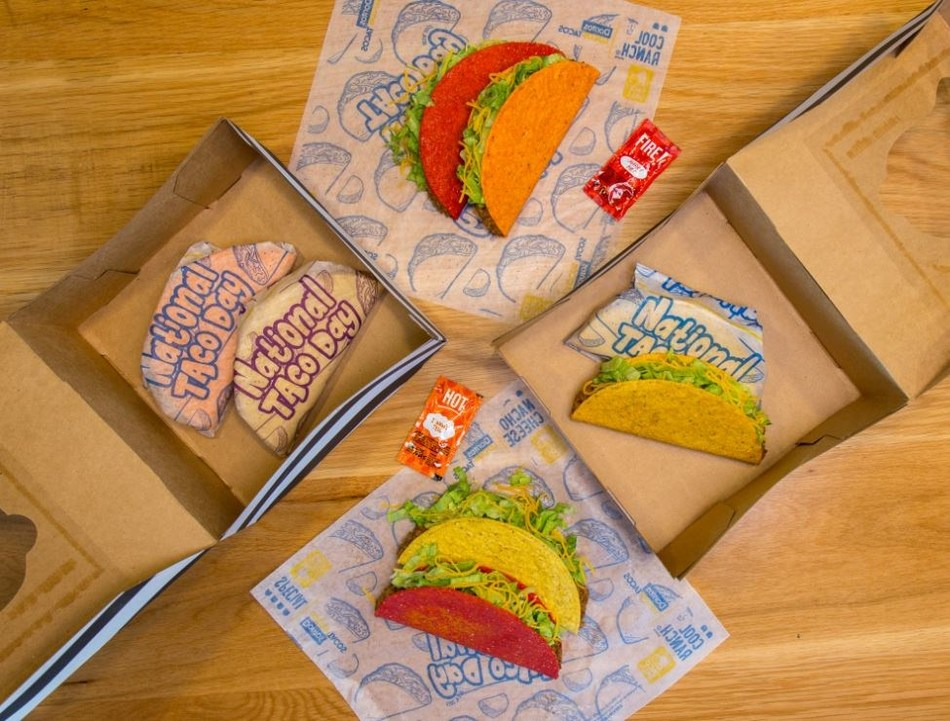 """Taco Bell will be offering a National Taco Day Gift Set in participating restaurants on October 4th only, equipped with customers' four classic Taco Bell tacos for five dollars: Nacho Cheese, Cool Ranch, and Fiery Doritos Locos Tacos and, of course, the iconic Crunchy Taco, all """"gift wrapped"""" in a limited edition wrapper and specially boxed."""