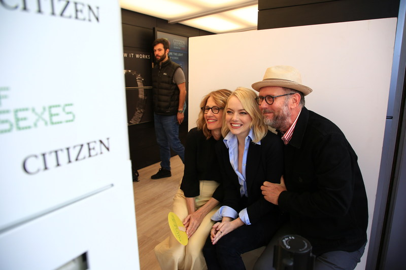 Emma Stone with Battle of the Sexes Directors, Jonathan Dayton and Valerie Feris visit the Citizen Watch Booth during the US Open Women's Finals.