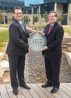 TMNA CEO Jim Lentz (right) receives the LEED Platinum Certification from Jonathan Kraatz (left), executive director,  U.S. Green Building Council, Dallas Chapter, for green building techniques on September 21, 2017.