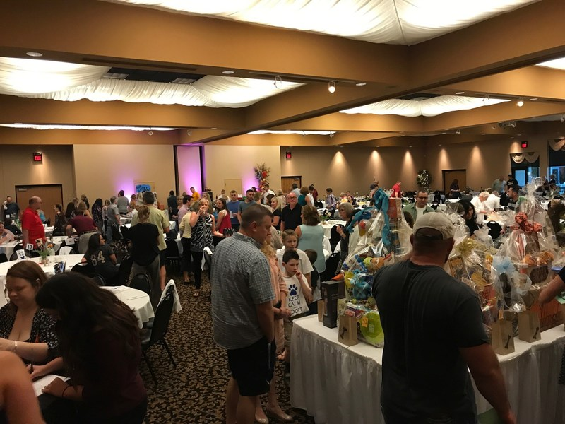 Attendees of the sold-out Petland Paws for Cause Fundraiser make bids on silent auction items before dinner and dancing. The event raised more than $16,500 for 3 partner shelters.