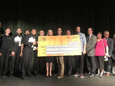 Band students, school officials, and executives from Toyota, VH1 Save The Music Foundation and Life is Beautiful Festival on stage during the grant presentation at Clark High School in Las Vegas.