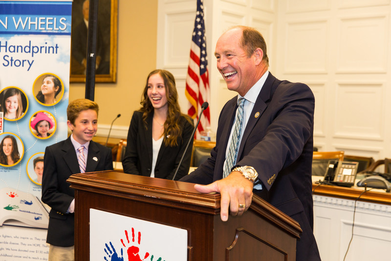 (Right picture) Hope On Wheels Youth Ambassadors Ryan Darby, Hannah Adams and Rep. Ted Yoho (R- FL)