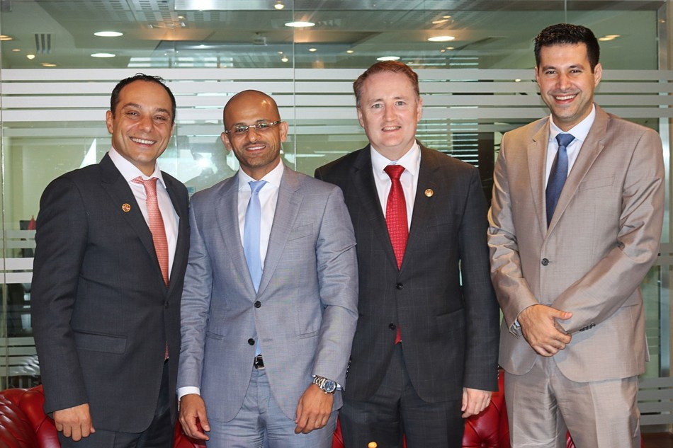 Dr Mishal Alkasimi, CEO of Specialized Rehabilitation Hospital with the InterSystems team during the signing ceremony of the partnership between Capital Health and InterSystems in Abu Dhabi.  From left to right: Michel Amous, Managing Director for the Middle East, Italy, and India at InterSystems, Dr Mishal Alkasimi, CEO of Capital Health's Specialized Rehabilitation Hospital, Robert Long, Business Development Manager for the Middle East at InterSystems and Ali Abi Raad, Director of Sales for the Middle East at InterSystems. (PRNewsfoto/InterSystems)