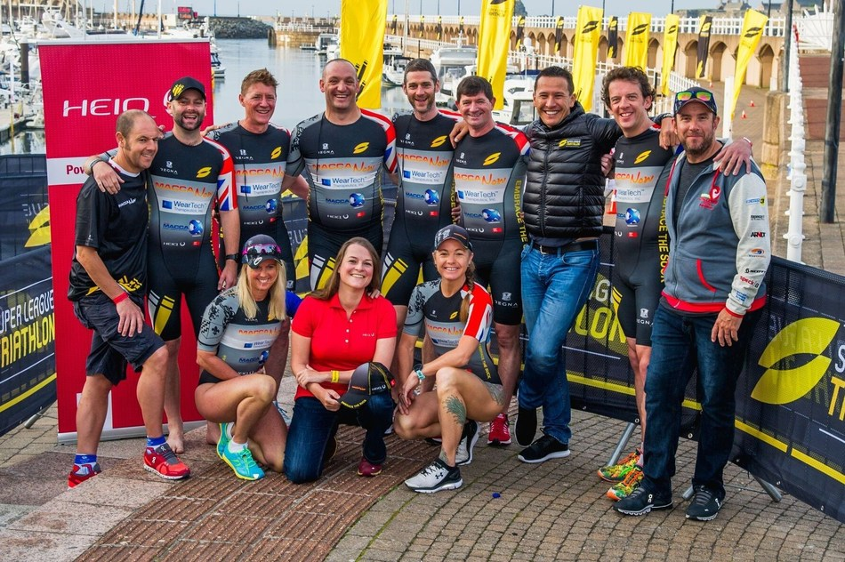 MaccaNow Foundation supporting team at the Super League Jersey Island, with Chris McCormack (third from right) (PRNewsfoto/HeiQ Materials AG)