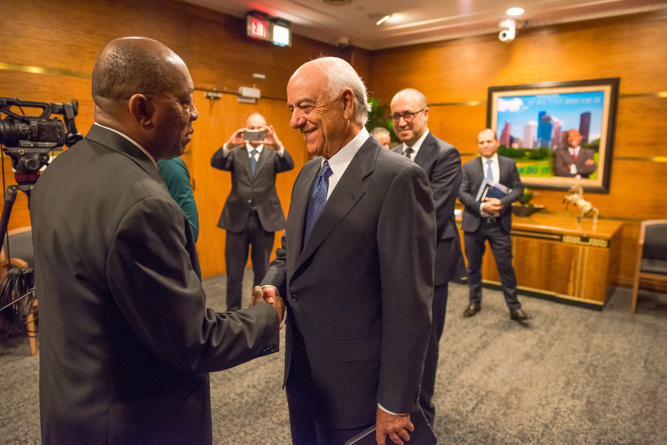 BBVA Executive Chairman Francisco González, right, greets Houston Mayor Sylvester Turner at City Hall on Friday.
