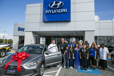 BAYTOWN, TX - SEPTEMBER 25: Henry Rogers (left) poses with his family and members of Baytown Hyundai after receiving a 2018 Hyundai Elantra September 25, 2017 in Baytown, TX.  Henry Rogers was given the car for being an extraordinary first responder during Hurricane Harvey.  (Photo by Drew Anthony Smith/Getty Images)