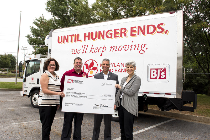 Al Langlais, General Manager of BJ's Wholesale Club in Baltimore, MD (second from left) presents a $100,000 donation from BJ's Charitable Foundation to Meg Kimmel, Chief External Affairs Officer (left), Carmen Del Guercio, President & CEO (second from right) and Laura Urban, Senior Director of Giving (right), of the Maryland Food Bank.