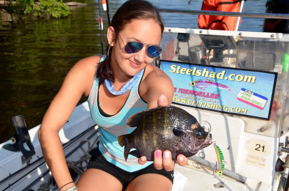 Ms. Amy Gable with bluegill caught on the original SteelShad.
