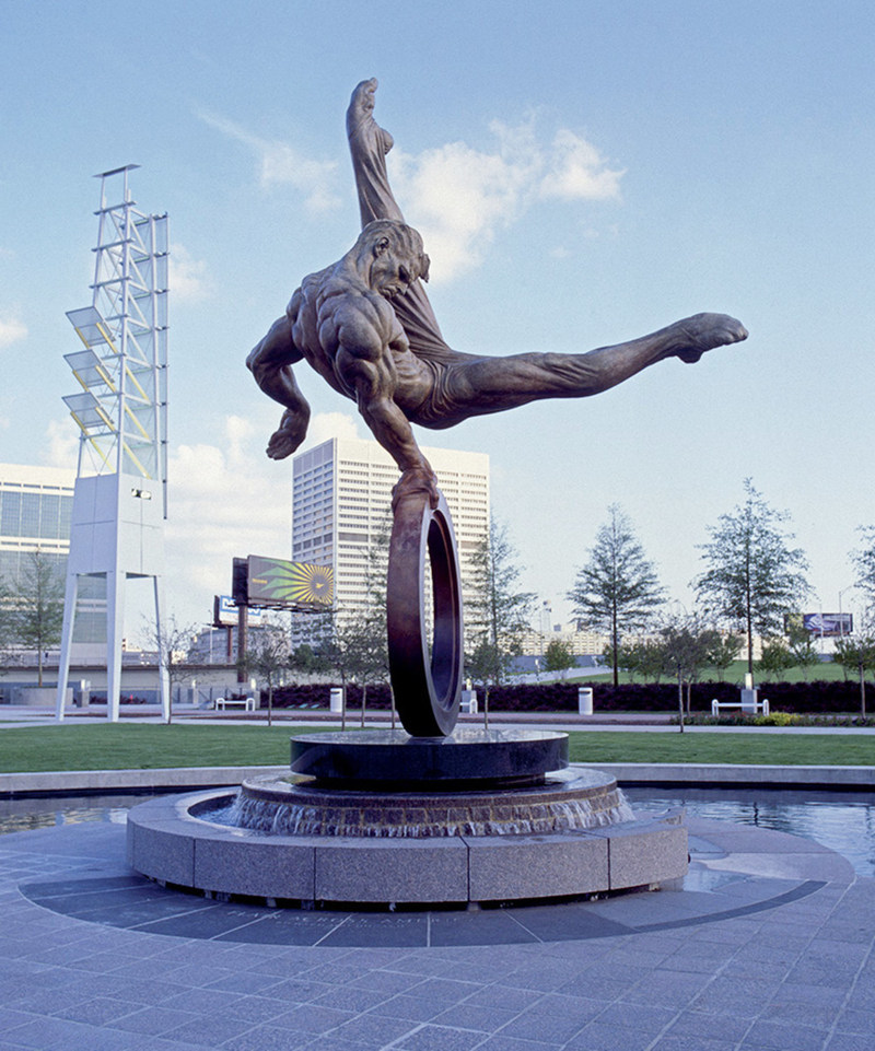 """Created for the 1996 Atlanta Olympics, """"Flair Across America - The Gymnast"""" by sculptor Richard MacDonald is a celebration of the triumph of the human spirit - the dedication, tenacity and determination of every individual in the pursuit of excellence.  Flair Across America is a the 26-foot high heroic bronze monument that resides permanently at Georgia International Plaza in Atlanta, Georgia."""