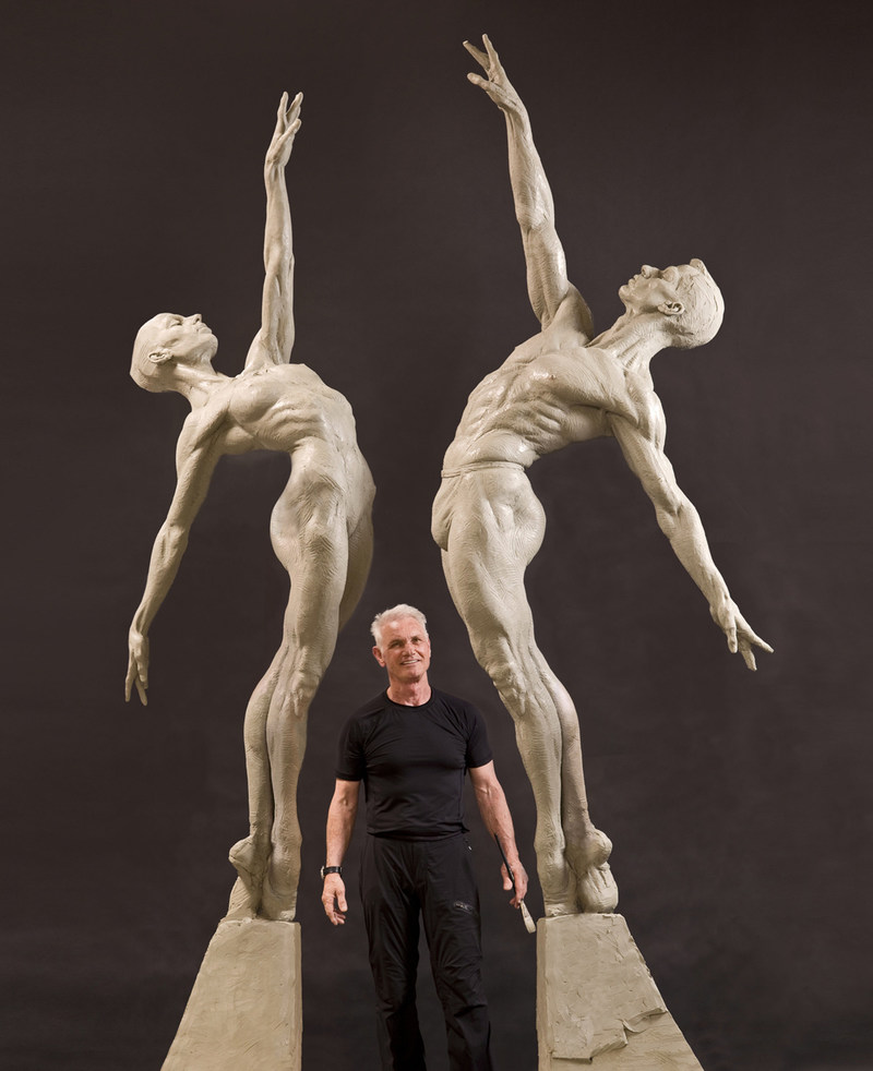 Richard MacDonald stands with the Male and Female Allonge sculptures created for the Royal Ballet in London.
