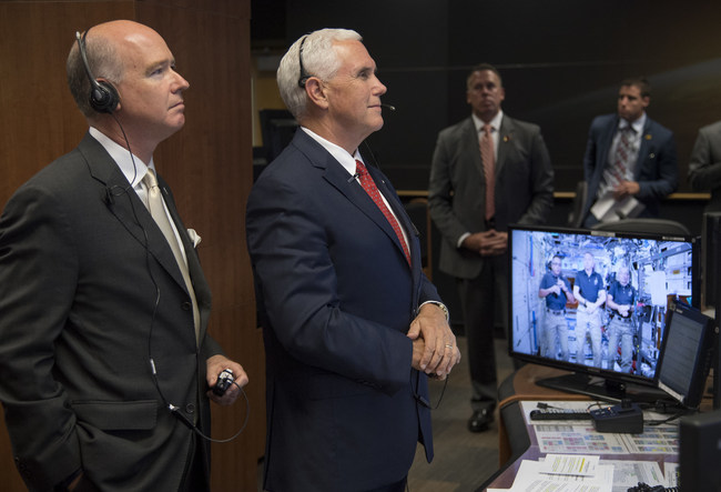 Vice President Mike Pence, right, and Rep. Robert Aderholt, R-Ala., talk with Expedition 53 crew members Joe Acaba, screen left, Randy Bresnik, screen center, and Mark Vande Hei onboard the International Space Station from the Payload Operations Integration Center (POIC) of the NASA Marshall Space Flight Center, Monday, Sept. 25, 2017 in Huntsville, Alabama.