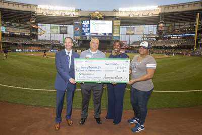 Associated Bank and Brewers Community Foundation present a check in the amount of $100,000 to Housing Resources, Inc.