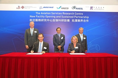 Prof Timothy W. Tong, PolyU President (seated left), and Ms Elisabeth Martin, Vice President, Boeing Research & Technology – China, The Boeing Company (seated right), sign an agreement to renew their collaboration for another five years. (PRNewsfoto/The Hong Kong Polytechnic Univer)