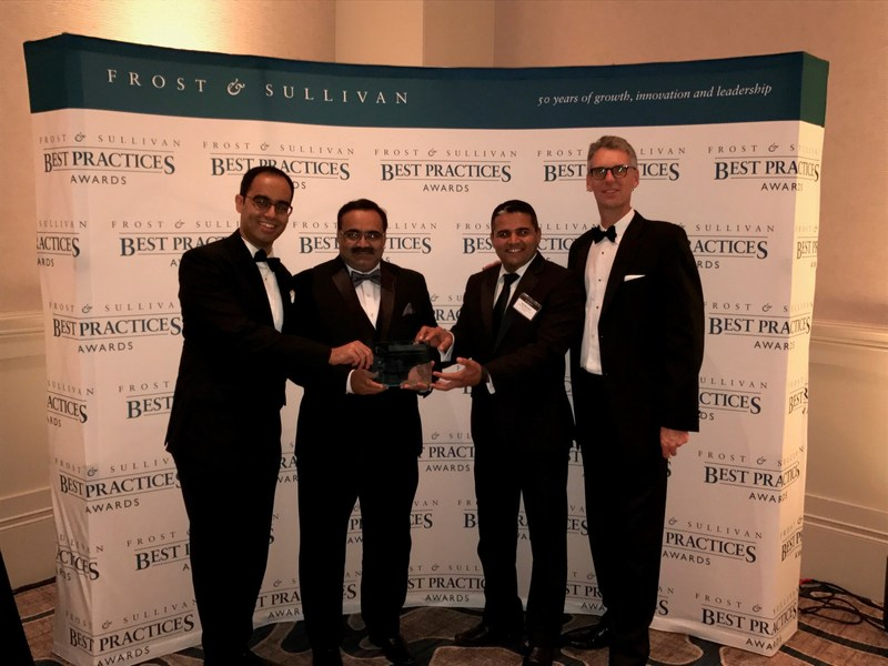 EcoEnergy accepts the prestigious 2017 Global Energy Management Systems Customer Value Leadership Award from Frost & Sullivan. Left to Right: Shawn Menezes, Mansoor Ahmad, and Rajender Beniwal from EcoEnergy; Mead Rusert from Automated Logic.