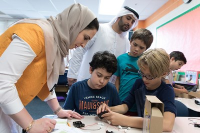 Beacon of Hope and UAE Embassy diplomats work with students in Washington, DC to build solar lights to send to children in refugee camps around the world.