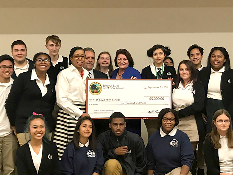 "Barona Tribal Chairman, Edwin ""Thorpe"" Romero, presented the $5,000 Barona Education Grant Program check to Senator Atkins, Dr. Helen V. Griffith and students of e3 Civic High School."