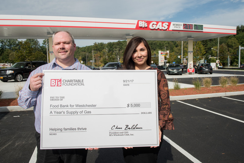 Chris George, General Manager of BJ's Wholesale Club in Yorktown, Heights, NY (left) presents a $5,000 donation from BJ's Charitable Foundation to Ayesha Khan, Senior Director of Fund Development (right) of the Food Bank for Westchester.