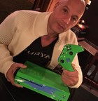 Vin Diesel with the Paul Walker Inspired Xbox One S Console to be raffled off on Sunday, October 1 during Reach Out WorldWide's  livestream charity event, Game4Paul on Mixer.com/xbox (PRNewsfoto/Xbox)