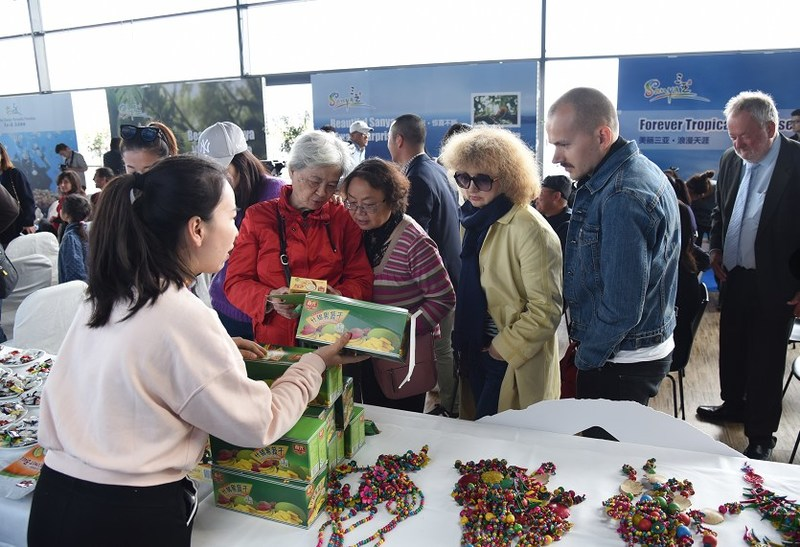 Copenhagen-based attendees visiting the exhibition area for Sanya's local specialty products