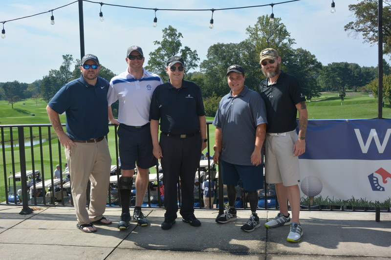 PenFed Credit Union Board Chairman Ed Cody (center) with veterans Scott Allen, Matt Anderson, Nick Thom and Jason Haag.