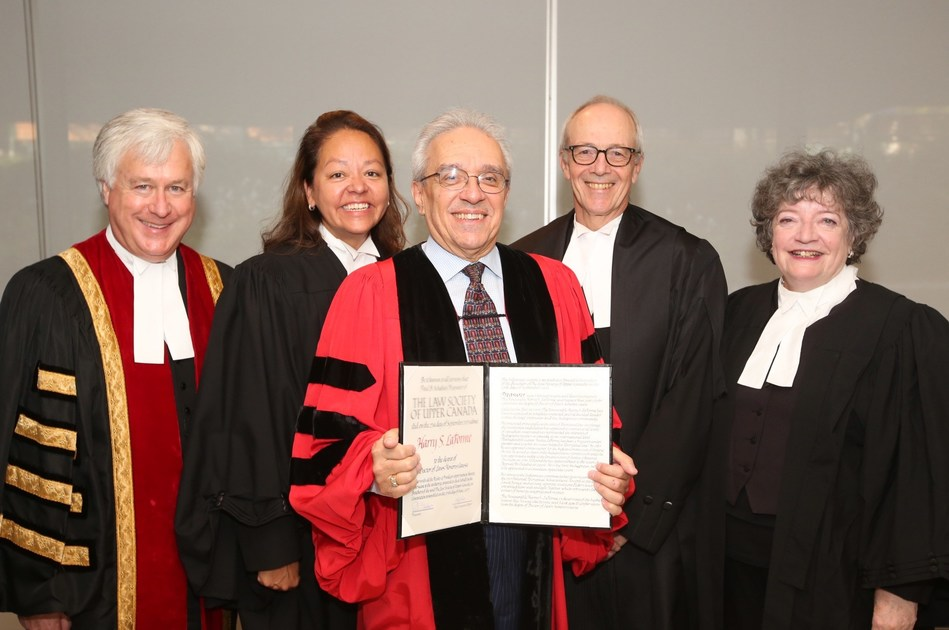 The Honourable Harry S. LaForme, centre, received an honorary Doctor of Laws degree (LLD) from the Law Society at its Call to the Bar ceremony in Toronto on September 27. Shown congratulating Justice LaForme are, from left to right: Law Society Treasurer Paul Schabas, Law Society Bencher Dianne Corbiere, The Honourable George R. Strathy, Chief Justice of Ontario, and former Treasurer Janet Minor. Justice LaForme received the LLD for his dedicated leadership within the legal profession and the Indigenous community. (CNW Group/The Law Society of Upper Canada)