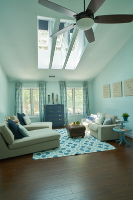 Lifestyle blogger, Designer Trapped, completed a bedroom transformation featuring skylights with navy blue blinds.